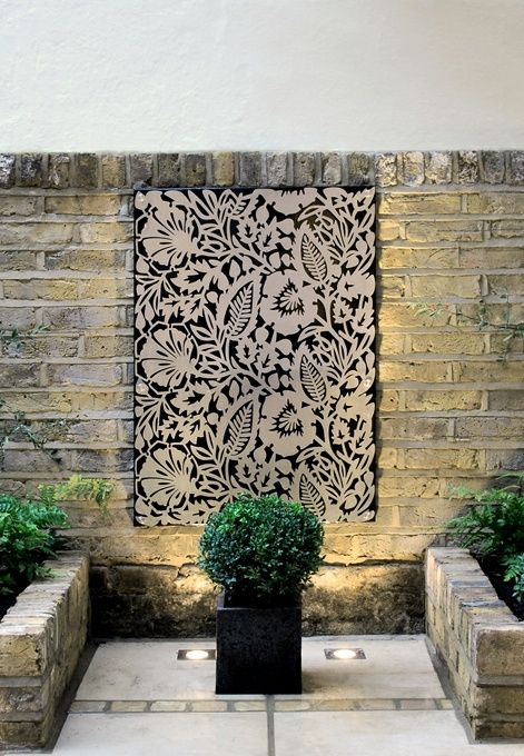 habiller un mur de dentelle metallique paysagiste Clermont-Ferrand